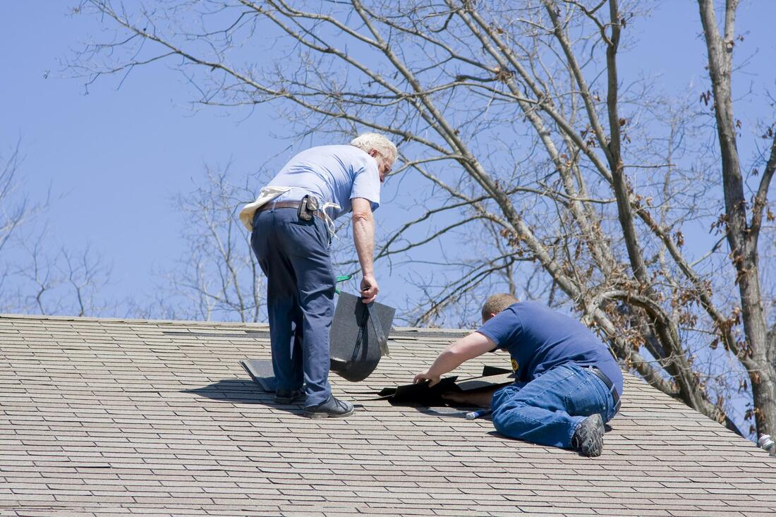 construction worker doing roof maintenance